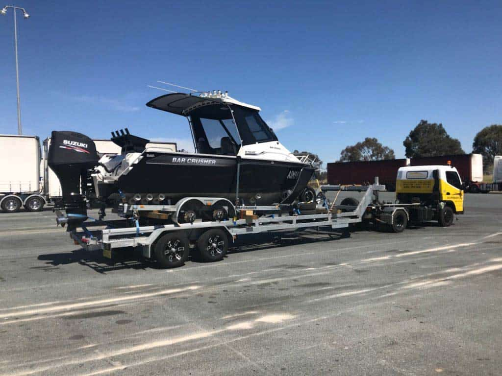 A trailer boat getting transport to another state by Slip Away marine transportation