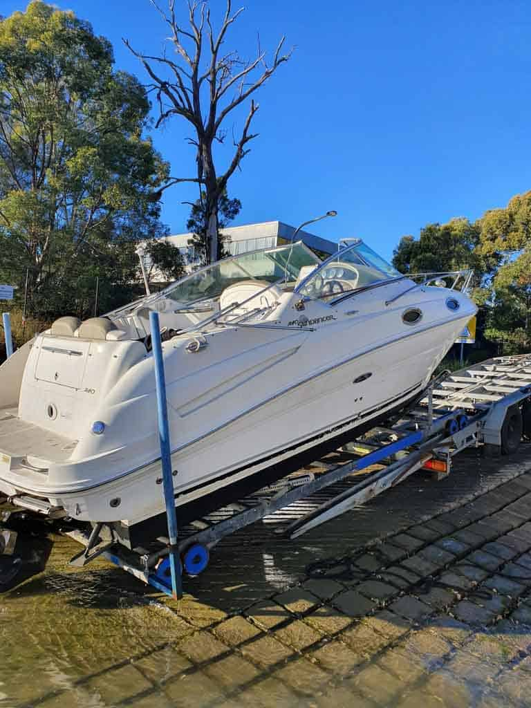 A boat going into the water off a slip cradle hire from Slip Away in Sydney instead of a boat trailer