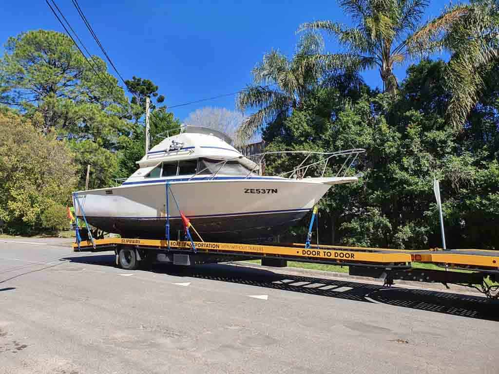 Slip Away delivering a 24 foot boat for sale with its door to door boat transport service