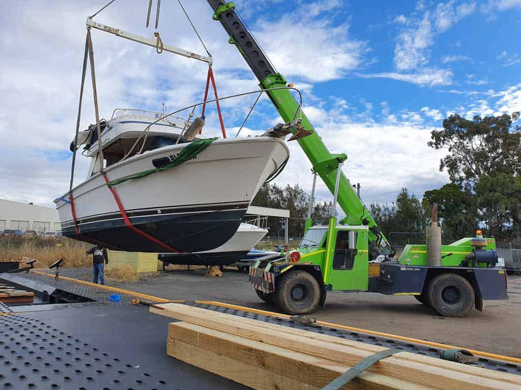 Slip Away marine transport service lifting a boat to be moved interstate the first step