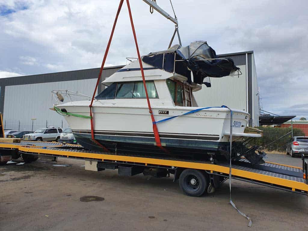 Slip Away marine transport service lifting a boat to be moved interstate the second step
