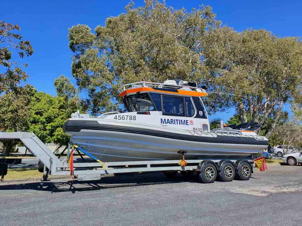 Slip Away marine transport service moving a new boat for sale for the Maritime Board