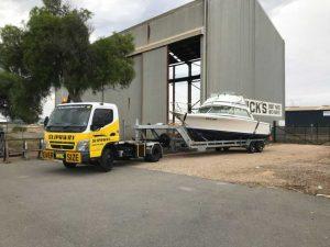 Slip Away providing marine transport to a warehouse for boat storage