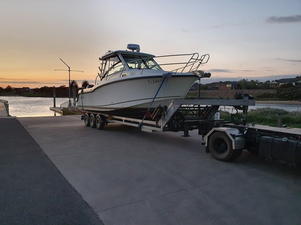 Slip Away Boat Transport doing float on and float off transportation of a 285 Boston Whaler back to Patterson Lakes in Victoria from a fishing trip down in Portland at sunset