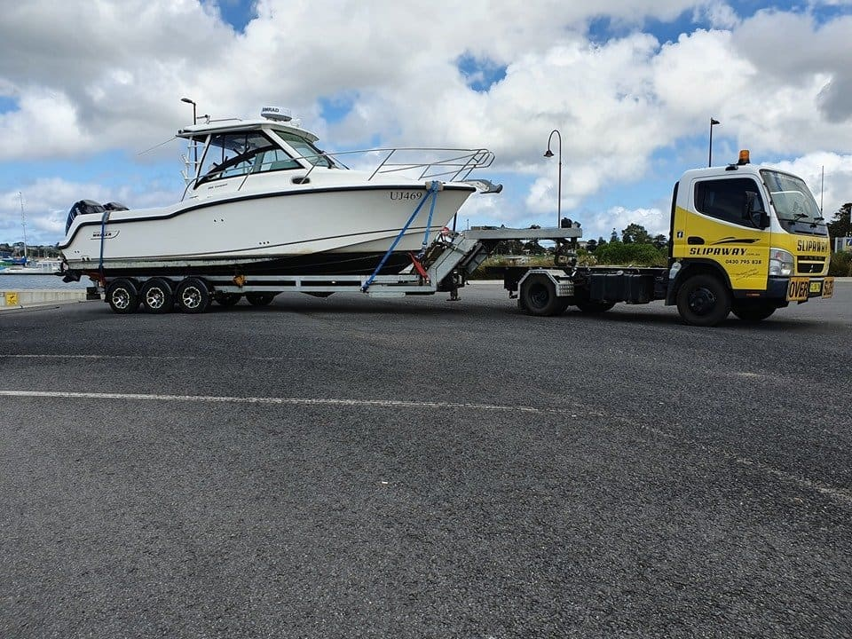 Slip Away Boat Transport doing float on and float off transportation of a 285 Boston Whaler back to Patterson Lakes in Victoria from a fishing trip down in Portland on the road