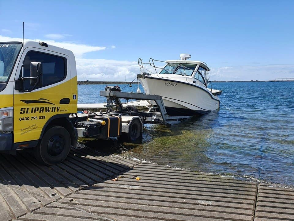Slip Away Boat Transport doing float on and float off transportation of a 285 Boston Whaler back to Patterson Lakes in Victoria from a fishing trip down in Portland