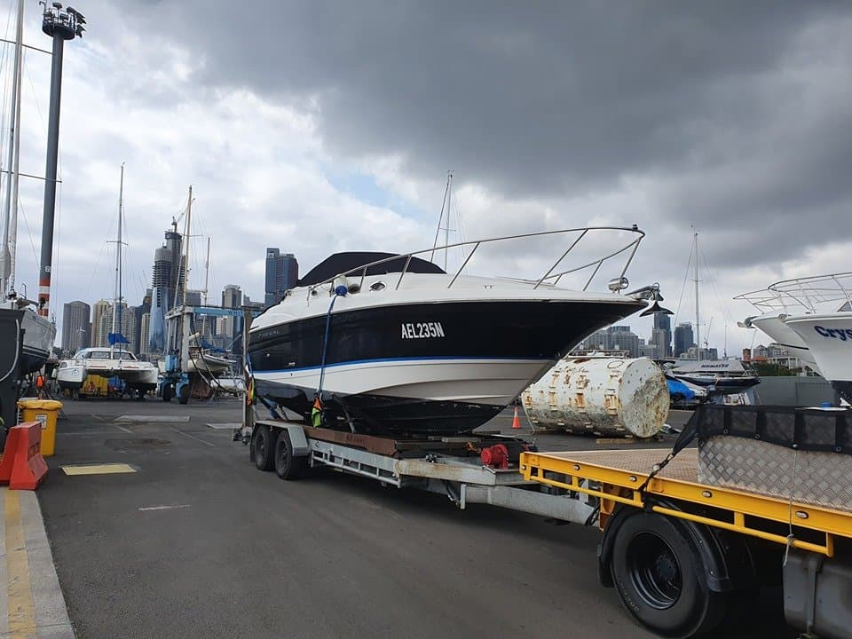 Slip Away Boat Transport moving a Regal 2800 on a mobile slip cradle for hire. Picked up from White Bay 6 marina in Balmain and delivered to Arndell Park in NSW