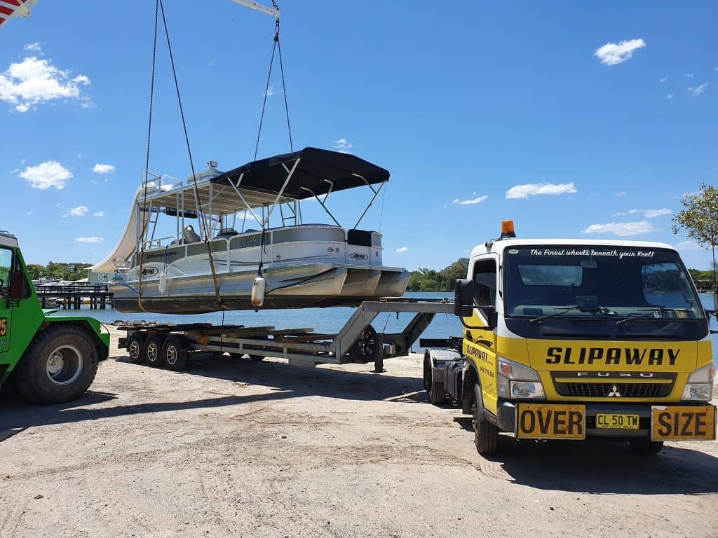 Interstate boat transportation for a twin hull pontoon being moved to Noosa in Queensland by Slip Away Boat Transport