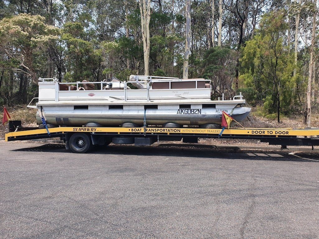 Slip Away doing an interstate boat transport run from Horizon Shores Marina Queensland to Yowie Bay in New South Wales with a twin hull pontoon. on the trailer