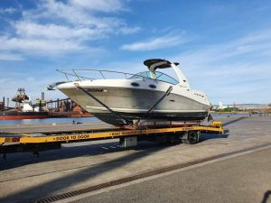 Transport a boat without a trailer - A Sea Ray Sundancer picked up from the boat ramp and transported on a trailer to Port Kembla via a boat cradle