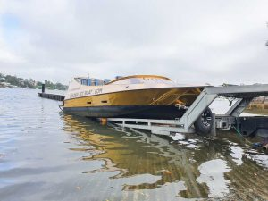 A commercial jet boat getting marine transport from a boat ramp in Sydney by Slip Away