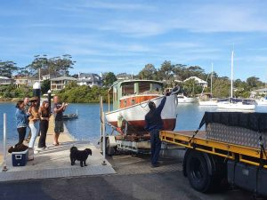 Slip Away Boat Transport reloating an old wooden boat from Alkira Boat Shed in Toronto NSW and delivering it to Rowland Reserve Boat Ramp for a family to put in the water