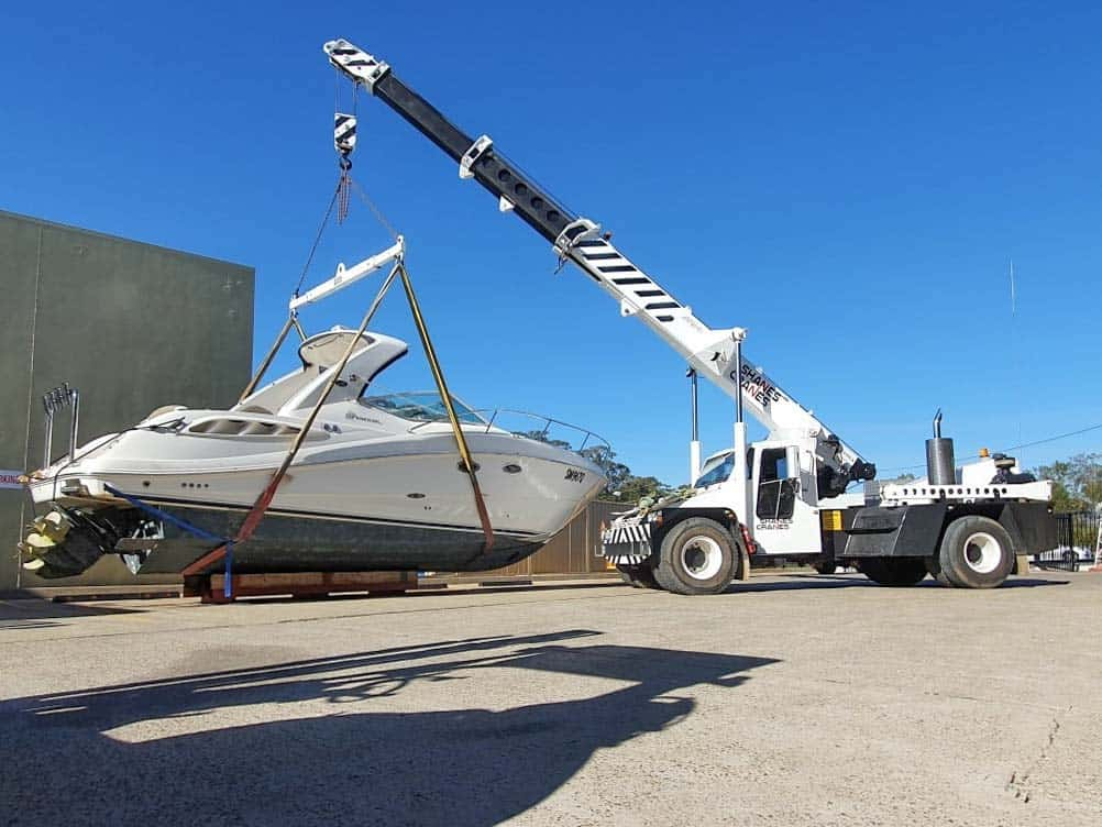 290 Sea Ray Sundancer Sports Cruiser boat being moved by road transportatoin from the Gold Coast to a Sydney marina to be lifted off with a crane and put into the water by Slip Away Boat Transport