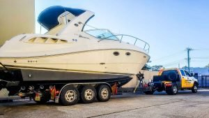 How to transport a boat bigger than 20 foot like a Sea Ray Sundancer 310 cruiser moved in Sydney by Slip Away boat transportation company from a marina to a boat ramp to be launched into the water again