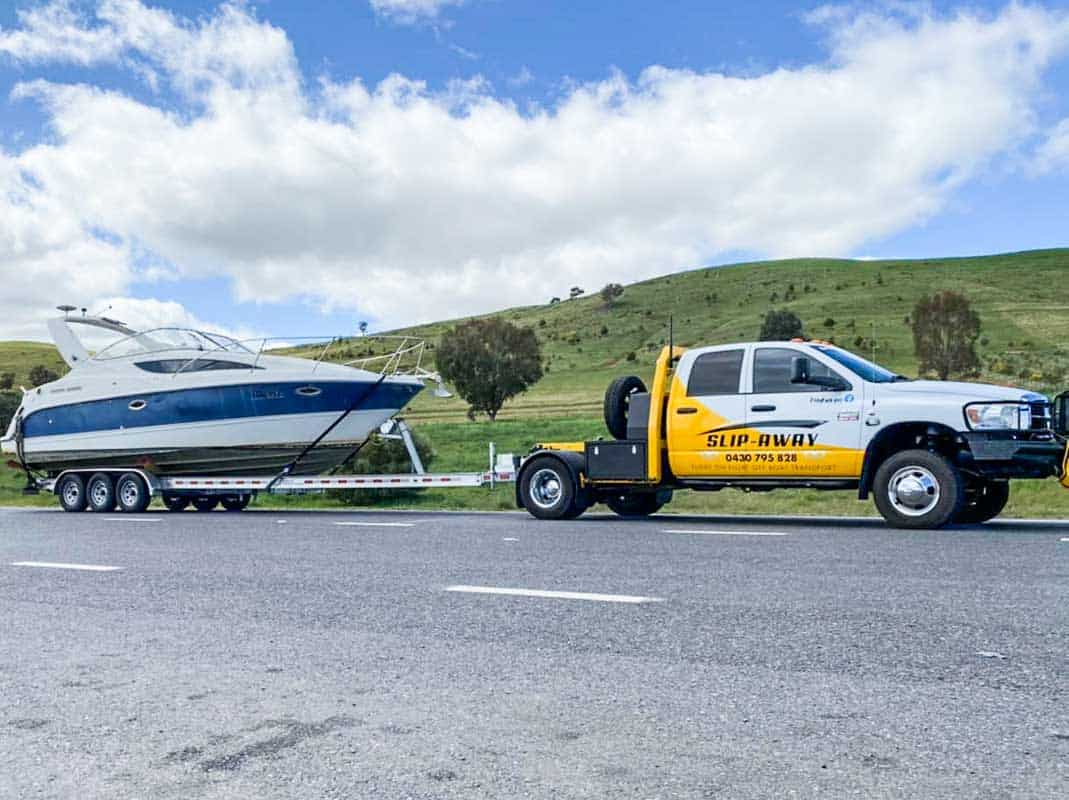 Slip Away interstate boat transportation company moving a Bayliner 285 cruiser boat by road haulage from New South Wales to Hastings in Victoria