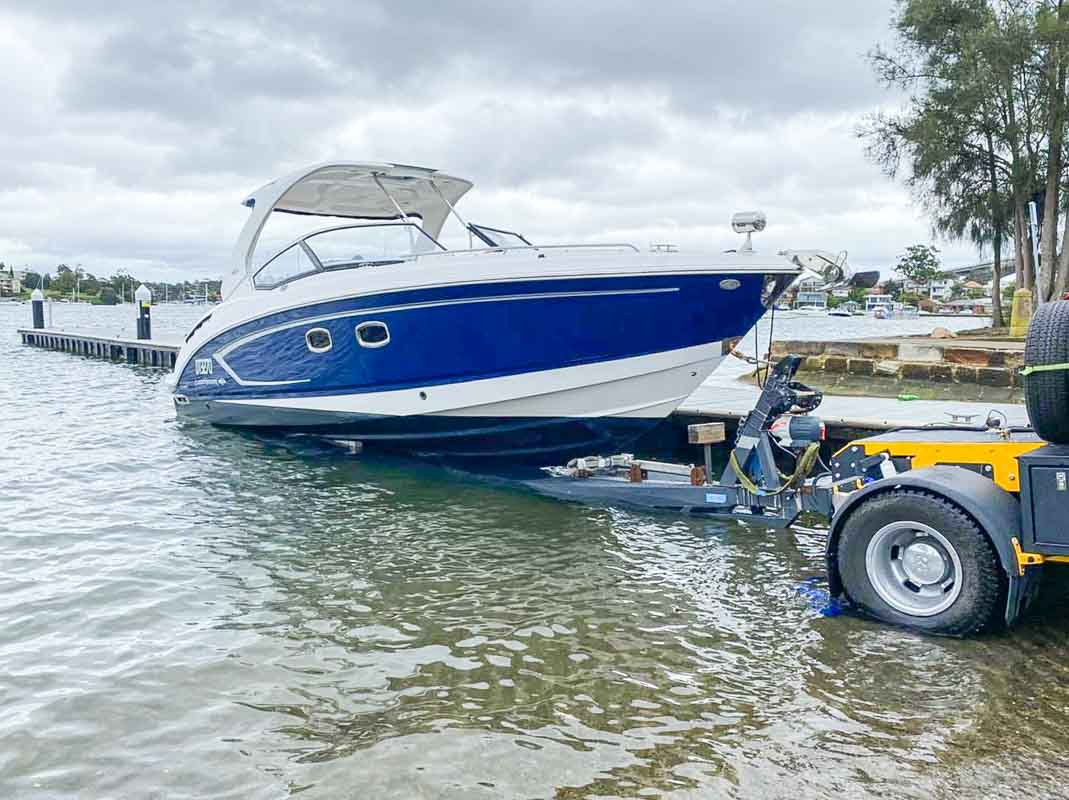 Float on Float Off Boat Transport A Chaparral 327 SSX Bow Rider boat getting transported from a boat ramp in Sydney to Rods Boats and Marine Repairs by Slip Away boat transport company