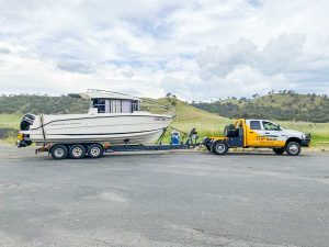 A Parker 8 getting boat haulage from NSW to Phillip Island in Victoria by Slip Away Boat Transport Company in Sydney on the highway