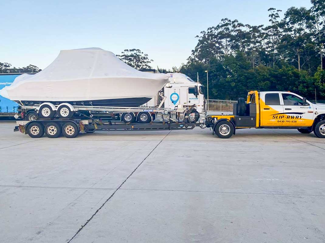 A brand new boat Nauticstar 25 VMAX 24 with twin 400 outboard motor transported from Yowie Bay in NSW by Slip Away boat transport company 1