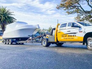 BOAT DELIVERY A BRAND NEW BOAT NAUTICSTAR 25 VMAX 24 WITH TWIN 400 OUTBOARD MOTOR TRANSPORTED FROM YOWIE BAY IN NSW BY SLIP AWAY BOAT TRANSPORT COMPANY AT A HOUSE