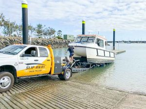 BOAT HAULAGE FROM FLOAT ON FLOAT OFF BOAT TRANSPORT SLIP AWAY HAULING A X MARTINE CATAMARAN BY ROAD IN SYDNEY TO THE BOAT RAMP