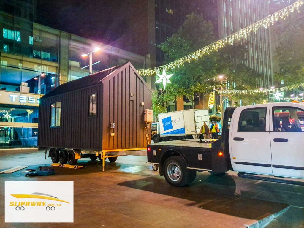 Tiny home transport hauling or moving in Sydney by Slip Away transportation business for trade shows