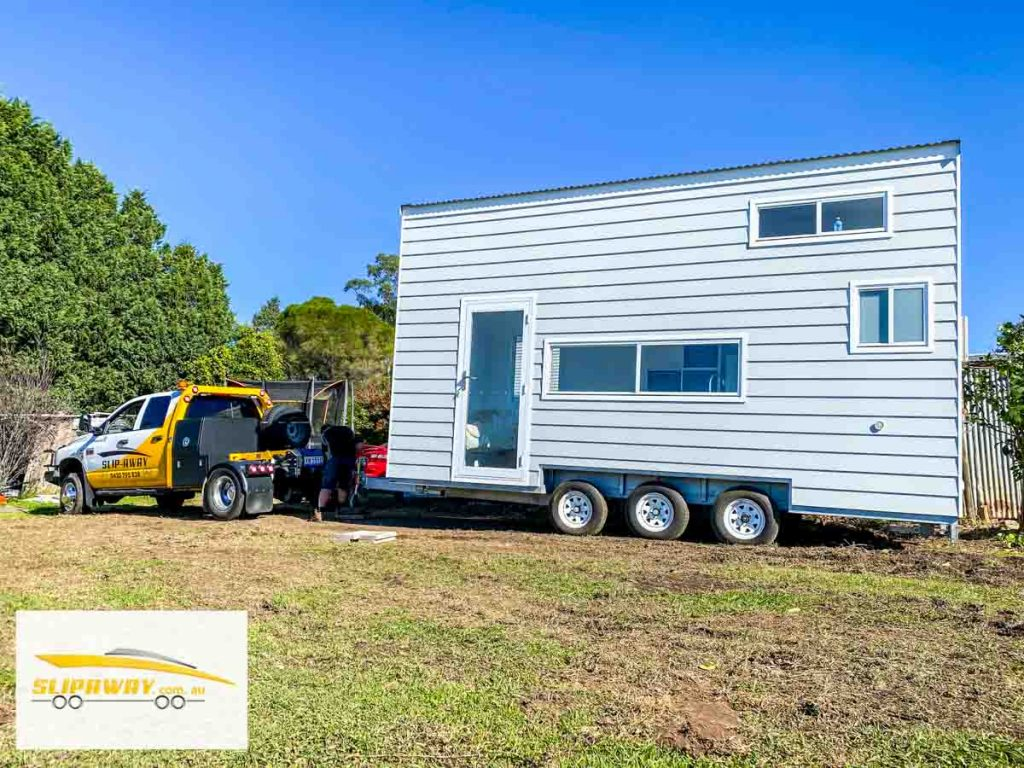 Tiny home transport hauling or moving in Sydney by Slip Away transportation business with a truck