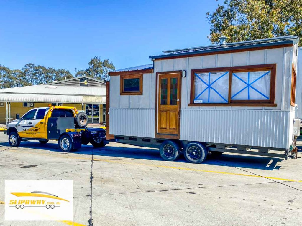 Tiny home transport hauling or moving in Sydney to Gosford by Slip Away transportation business