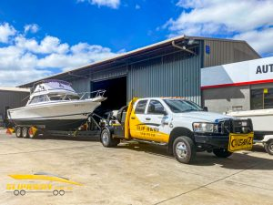 SLIP AWAY 50 WATERVIEW STREET CARLTON SYDNEY BOAT TRANSPORT COMPANY WITH A CARIBBEAN 26 FOOT FLYBRIDGE BEING MOVED BY ROAD