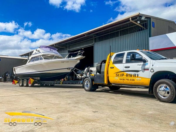 SLIP AWAY INTERSTATE BOAT TRANSPORT BY ROAD FOR CARIBBEAN 26 FOOT FLYBRIDGE FROM RM MARINE CAPEL MELBOURNE TO CAMERAY SYDNEY 2