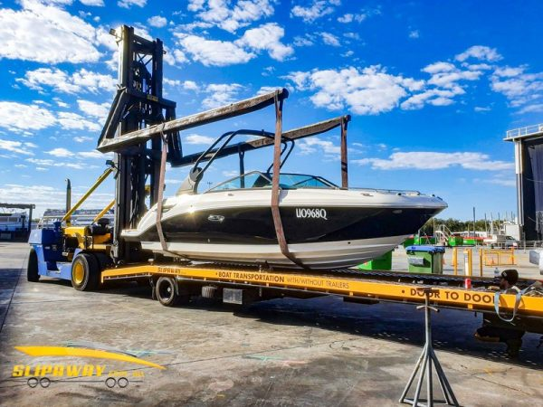 SLIP AWAY INTERSTATE BOAT TRANSPORT SEA RAY 250SDX AND A DOCK PRO SEAPEN FROM GOLD COAST CITY MARINA TO YOWIE BAY IN NSW GETTING LIFTED AT THE MARINA