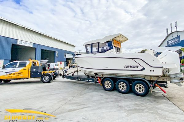 SLIP AWAY INTERSTATE BOAT TRANSPORT BY ROAD FOR ARVOR 705 FISHING BOATS 25 FOOT FROM SYDNEY TO GOLD COAST CITY MARINA