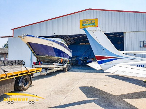 SLIP AWAY YACHT TRANSPORT ON A TRAILER BY ROAD FOR A SEARAY 30 FOOT BOAT FROM BANKSTOWN AIRPORT TO THE GOLD COAST